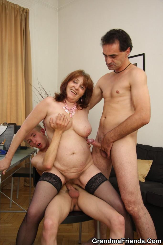 two matures stroking cock